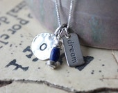Charm necklace with your choice of Initial charm, Word tag charm along with a blue & silver bead dangle