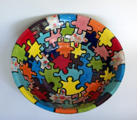 large ceramic serving bowl with colorful puzzle pieces. Black Bedroom Furniture Sets. Home Design Ideas