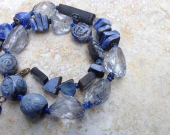 Necklace, Ultramarine blue, blue faceted quartz, kiln fired raku beads, organic
