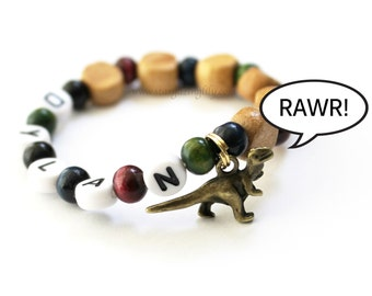 Dinosaur Party Favor Charm bracelet. Wood beads, Personalized name bracelet. The cutest dinosaur you've ever seen! Party Favor for boys.