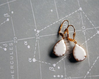 vintage milk glass white dangle earrings with carved scallop detail - gold plated lever backs