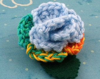 Crocheted Rose Lapel Pin - Light Blue and Rainbow (SWG-PL-MPRD02)