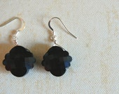 Black faceted cloud. Earrings