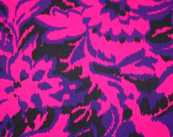 SALE vintage 80s fabric featuring magenta, purple and black stylized floral print, 1 yard