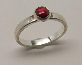 Sterling silver stacking ring with garnet gemstone