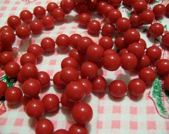 bright red strand of beads