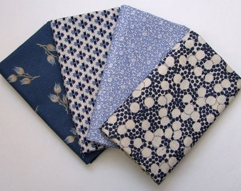 Set of four fat quarters in blue and cream