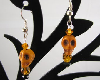 Orange Howlite skullies with orange and black accents on sterling wires