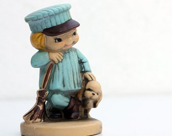 Little street sweeper and his puppy retro figurine