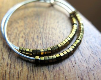 silver and gold earrings. mixed metal jewelry. hammered hoops.