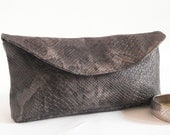 Clutch bag purse embossed vinyl vegan charcoal snake print python print magnetic fastening, zipped pocket