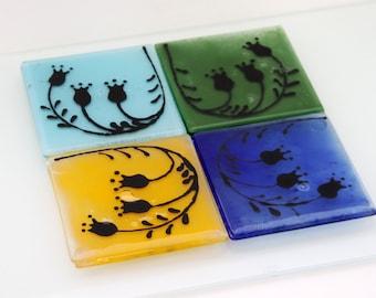 Glass coaster set,  Fused Glass Black Flowers Silhouette , set of 4 Blue, Orange, Green and Light Blue coasters