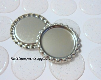 "100 pcs. FLAT SILVER  Linerless Bottle Caps and 100 pcs. 1"" GLITTER Epoxy Resin Bottle Cap Seal Sticker Kit."