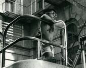 Black and White photograph of boy, urban photograph, Urban Landscape, wall art, home decor, boy playing
