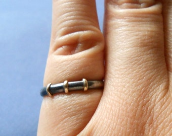Oxidised silver ring with solid 18kt gold accents