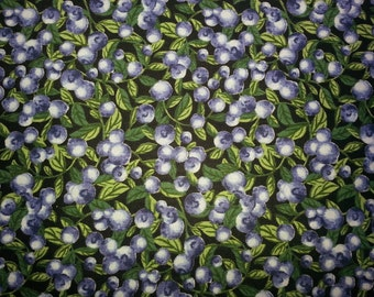 Blueberry print fabric on a black background.