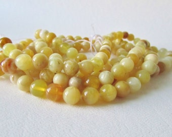 Buttery Yellow Honey Opal Smooth Polished Rounds, Half Strand