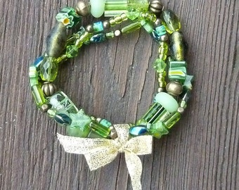 Peridot Green Stretch Bracelet Trio - Green Glass Beads, Cane Glass Beads, Gold Bow