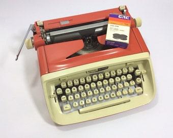 1960s Royal typewriter in orange with extra ribbon