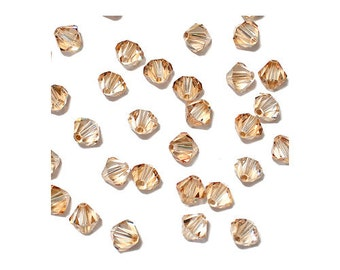 4mm Golden Shadow Faceted Bicone Beads - 24 bead pack - Swarovski 5301 - light gold colored - Austrian crystal jewelry beads