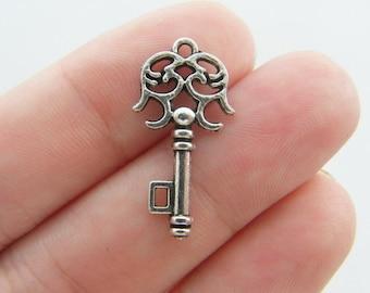10 Key charms 24 x 12mm tibetan silver K72