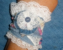 Beautiful lacy denim cuff bracelet with pink bead accents