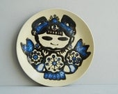 Modernist Japanese Ceramic Decorative Plate with Blue and Black Kokeshi Style Illustration of a woman