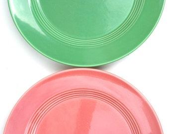 Two Harlequin dinner plates by Homer Laughlin. Medium green, red, art deco, mid century.