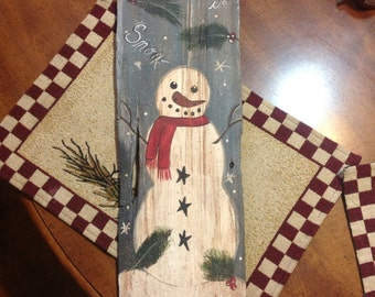 Hand painted snow man on old barn board