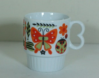 vintage mod owl and butterfly coffee mug in orange and green