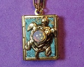 Turtle Love Locket- turquoise and gold, holding 14 ways to tell someone you love them, from English to American Sign Language.