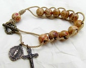 St Therese Sacrifice Bead Cord rosary Bracelet with Cream Wooden Beads