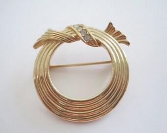 Vintage Avon Gold Tone and Rhinestone Circle Pin