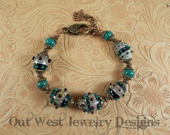 Hand Torched Chunky Lampwork Bead Bracelet Green, Black, Ivory and Bronze No. 34