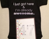 DISCOUNTED -- Nearly Perfect -- #47b, see photos -- I just got here & I'm already awesome.  -- black snapsuit, size 0-3 months