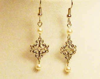 Delicate pearl and silver earrings