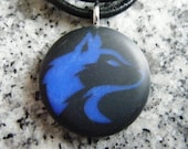 Husky design hand carved on a polymer clay black color background. Pendant comes with a FREE 3mm necklace
