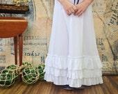 Girls White sleeveless dress with ruffles