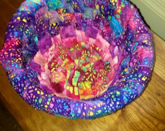 Woven pink and purple batik fabric basket