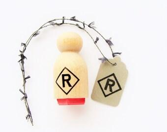 tiny initial cap rubber stamp (alphabet  #7)