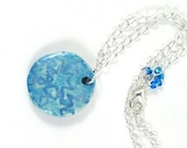 Round Ceramic Pendant Handmade Jewellery Baby Blue Stars Imprint on Asymmetrical Silver Chain with Seed Bead Accents