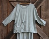 washed linen top in silver grey with hanging pocket