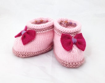 Knitted pink booties with a lambswool bow