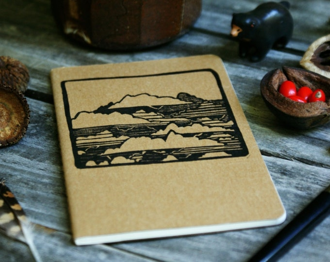 Featured listing image: Clouds in the Sky Brown Notebook Moleskine Journal Hand Carved Summer Camping Nature Cloudy Hiking Trail Camp Travel Journey