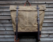 Waxed canvas extra wide rucksack/backpack with roll up top and waxed leather shoulderstrap,handle and leather bottem COLLECTION UNISEX