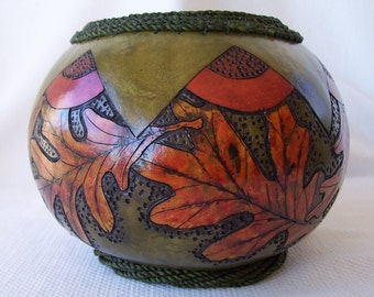 Medium green gourd bowl, wood burned leaves, coiled rim. 1697.