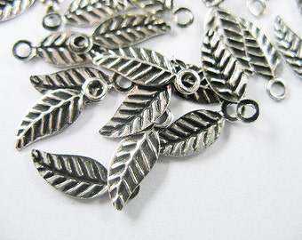 30 of 925 Sterling Silver Leaf Charms 4.5x10 mm. :th0526