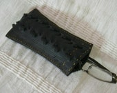 Hand stitched glasses case made from a recycled 'Raider' bicycle tyre.