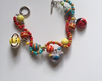 SALE,Happy fun bracelet full of whimsy, Colorful ceramic beads bracelet,ceramic beads from Jennifer Heynen collection,red, yellow,turquoise