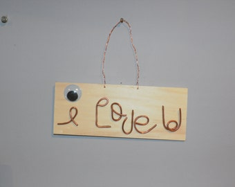 I love U, scrap copper wire and googley eye wall art- on wood plaque a fun loving re use sign